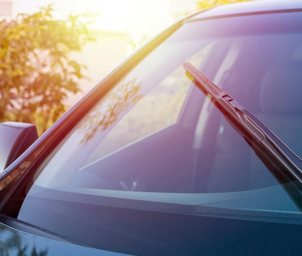 A AAA Member's windshield repaired by Safelite Auto Glass at sunset