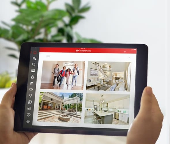 A AAA Smart Home customer monitors her home on a tablet