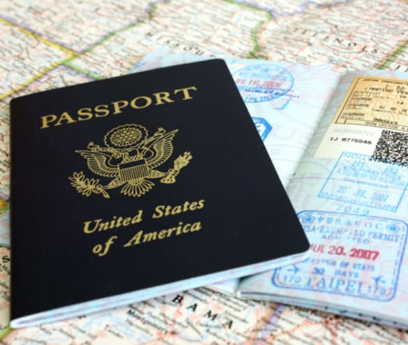 passport sitting on top of a map