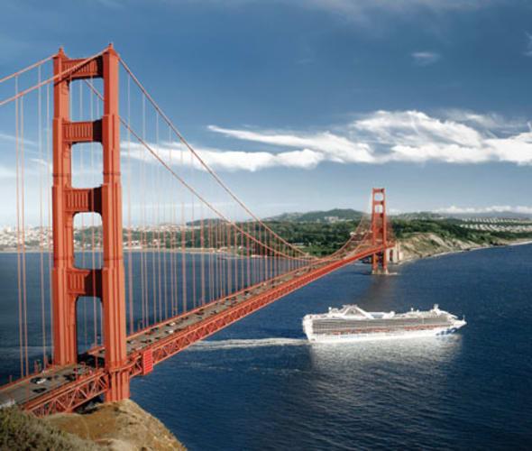 princess cruise ship sailing under golden gate bridge