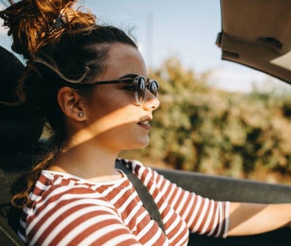 A teenage driver behind the wheel.