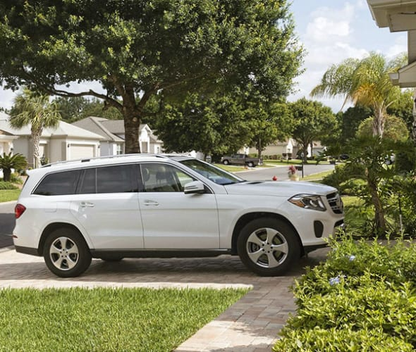 A white SUV parked in a AAA Member's driveway