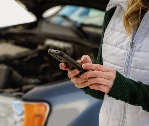 a woman requests AAA roadside service from the AAA mobile app