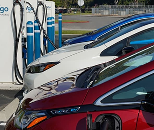 Electric vehicles charging at EVgo fast-charging stations