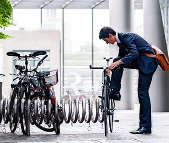 A AAA member locks their bicycle outside an office