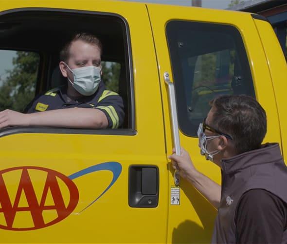 AAA's Todd Burger speaks to a Roadside Service Technician