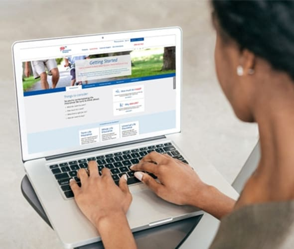Woman researching aaa life insurance policies on her laptop