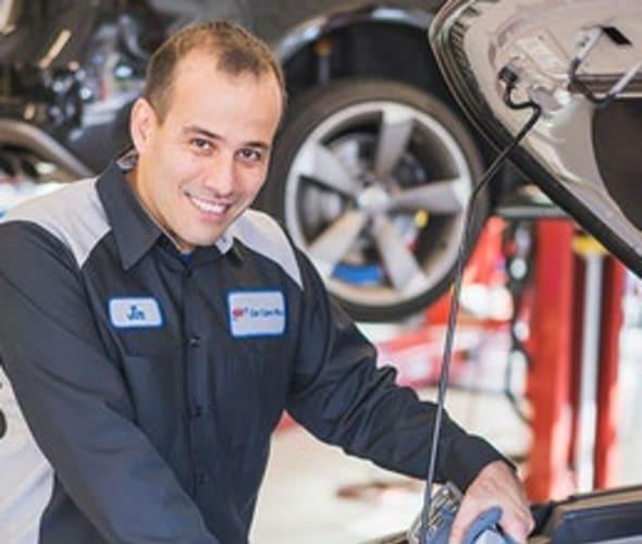 a AAA auto repair mechanic helps a customer