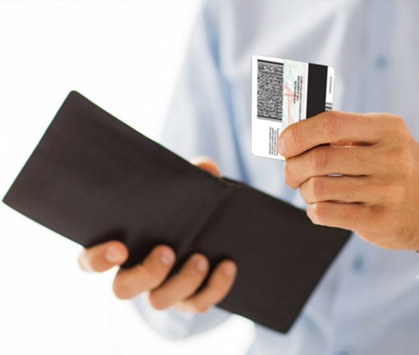AAA Member pulling a Real ID out of his wallet
