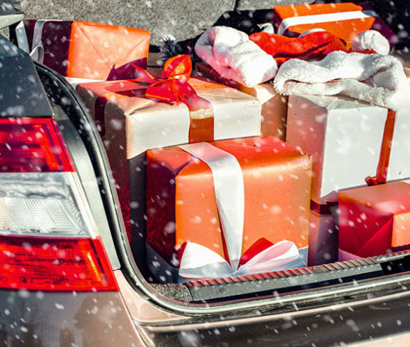 Trunk of a car full of wrapped presents