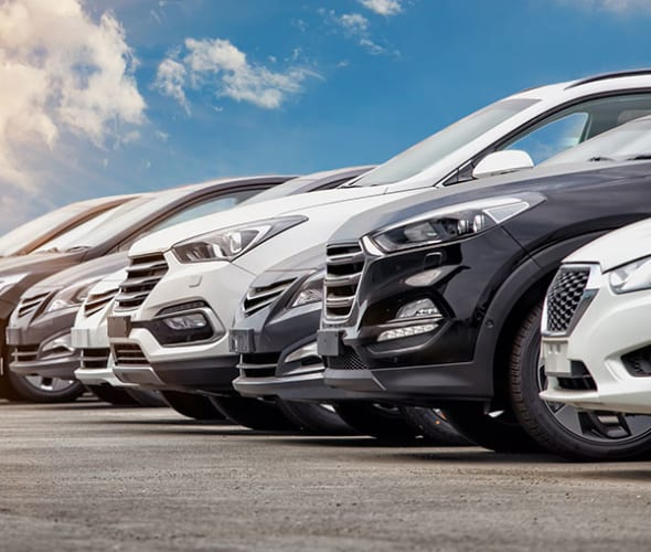 cars lined up at a dealership