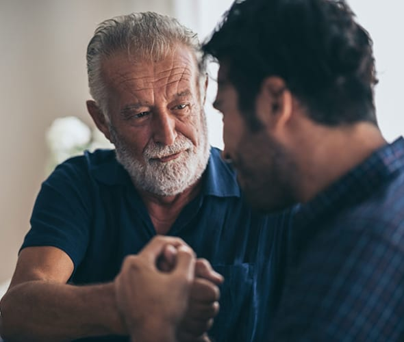 a son talks to his aging father about driving safely