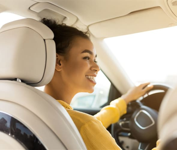 a teenager at the wheel of a car insured by AAA