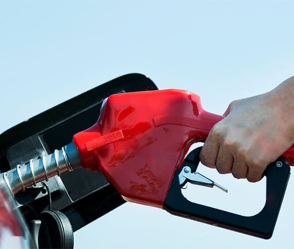 A person shown pumping gas.