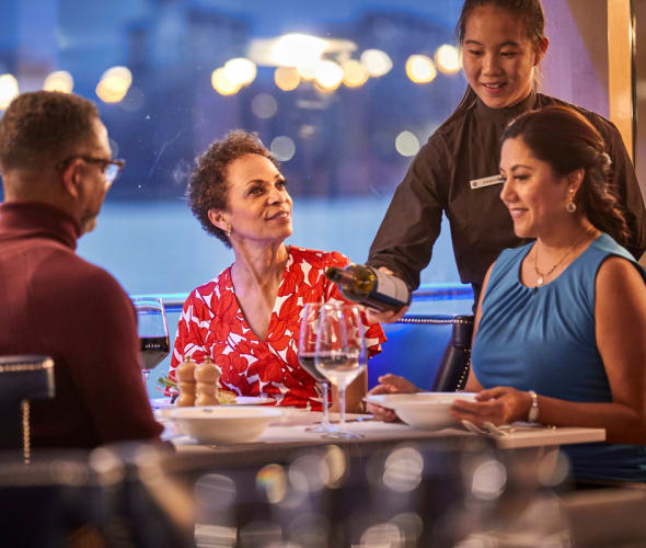 server pouring wine on a uniworld river cruise