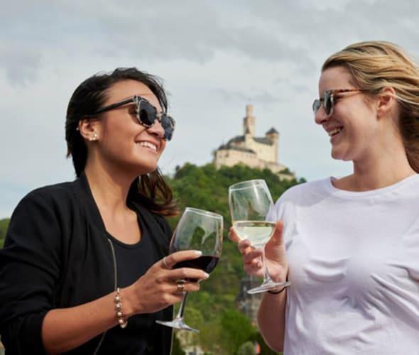 woman drinking wine on a u by uniworld river cruise