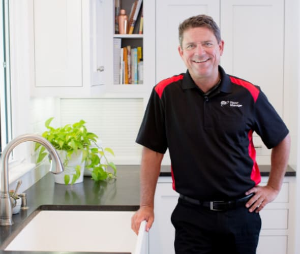 a friendly AAA House Manager inspects a home for maintenance and repairs