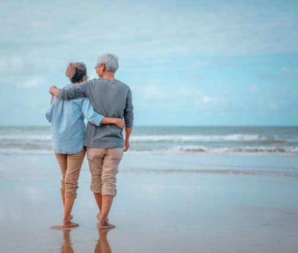 AAA Members with AAA Life Insurance walking on the beach