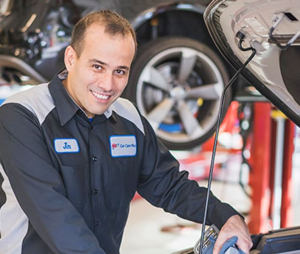 a AAA auto repair technician helps a customer