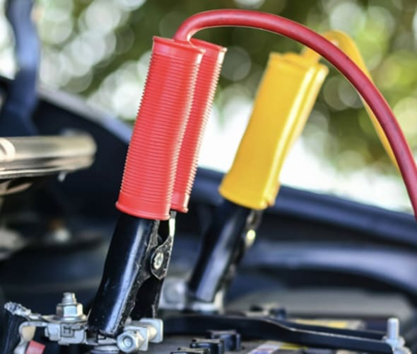 Car battery being diagnosed by AAA Mobile Battery Service