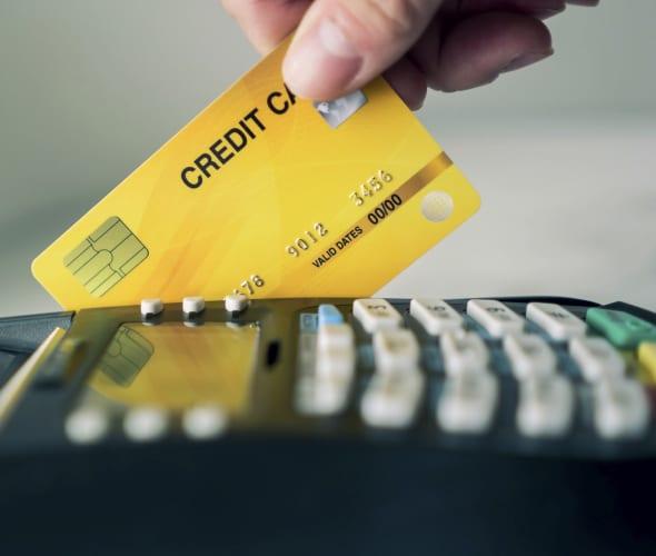 Swiping a credit card at pay device.