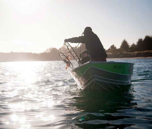 Fisherman checking crab pots off Oregon coast.