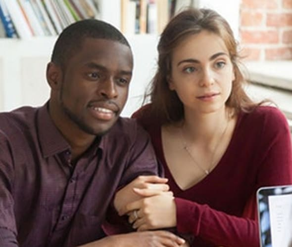 Couple discussing AAA renters insurance with an agent
