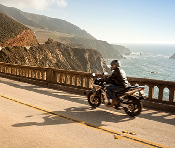 Motorcycle driving alone down the coast of California