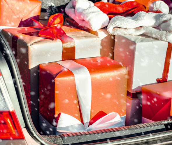 gifts piled in the trunk of a car