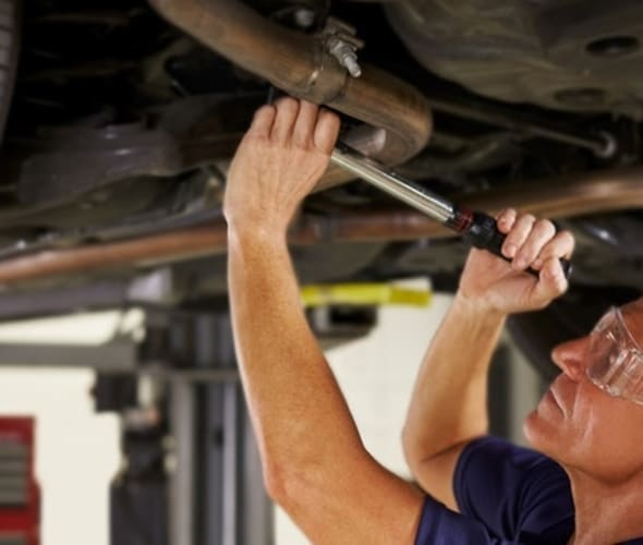 A AAA car mechanic repairs an auto in the shop