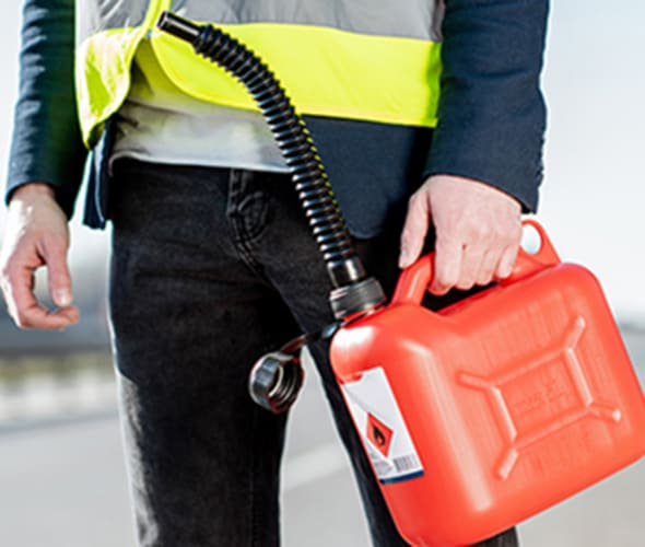 a aaa employee delivers gas to a stranded driver