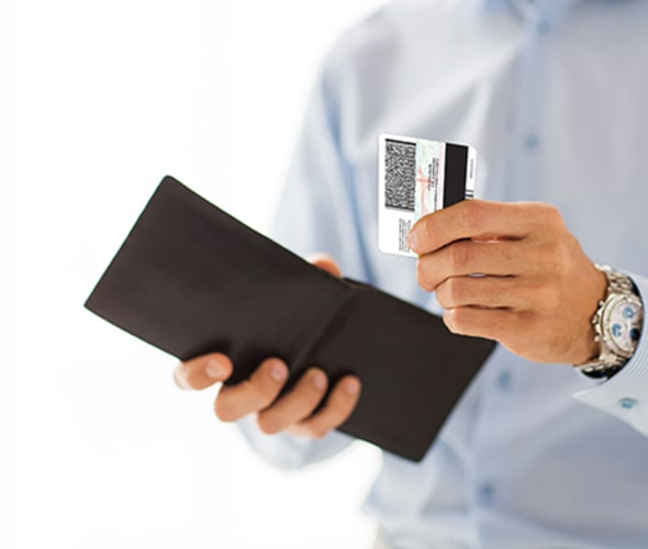 man replaces ID in wallet