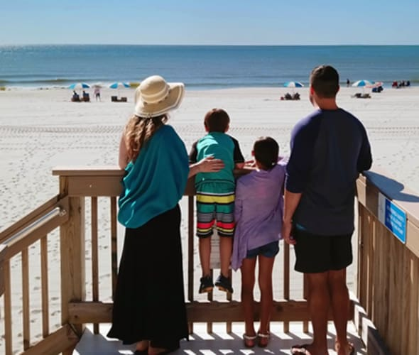 Family on hotel beach stairs booked using Best Western Rewards
