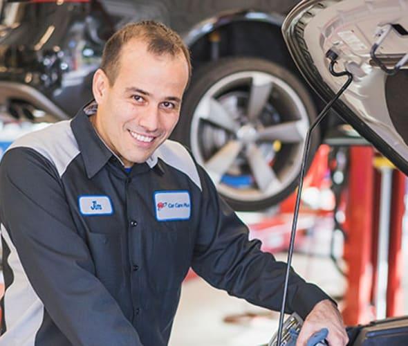 AAA mechanic repairs car in AAA body shop