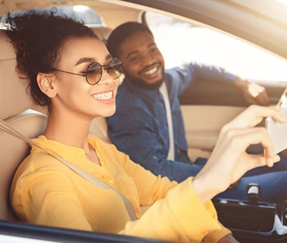 a couple with aaa car insurance takes a selfie on their road trip