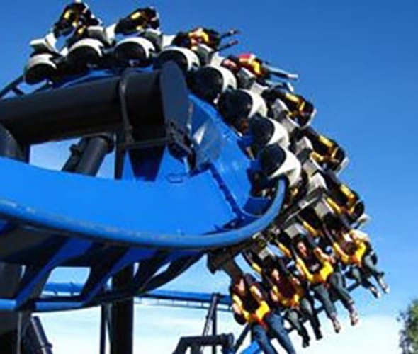 people on roller coaster at six flags magic mountain
