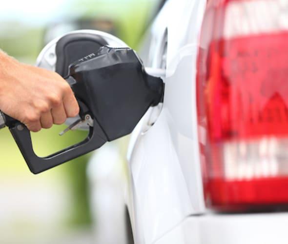 AAA Member pumping gas