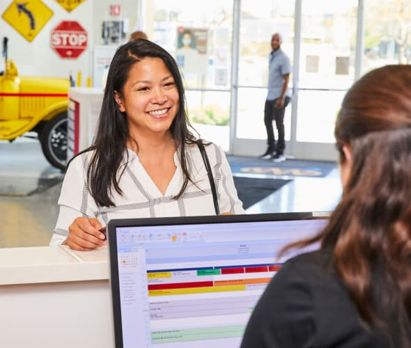 AAA Member is helped at AAA Auto Repair Center front desk.