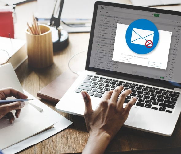 A person clears phishing emails out of their inbox.