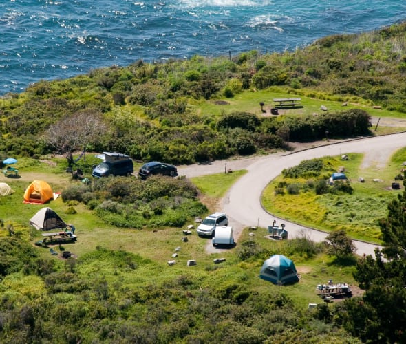 Aerial view of tents set up at Kirk Creek Campground in Los Padres National Forest near Big Sur, California.