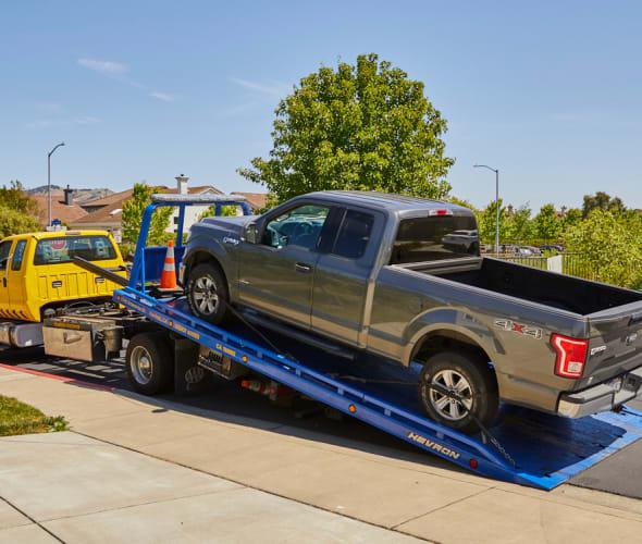 AAA tow truck picks up a broken down truck.
