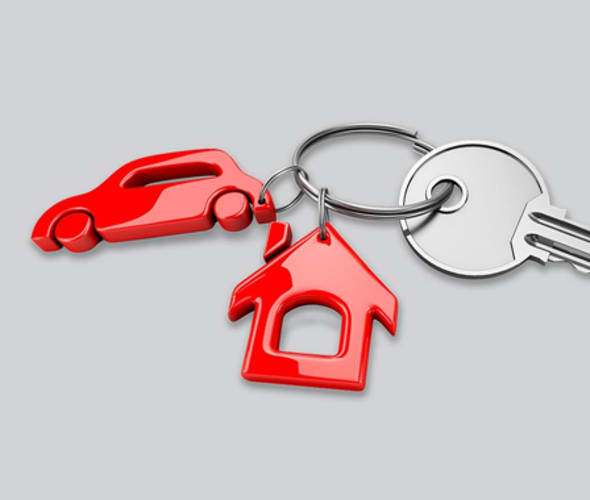 keychain in the shape of a house and a car with keys attached