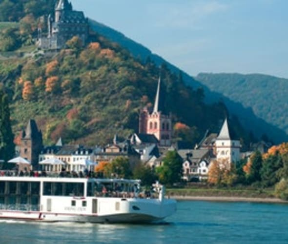 viking river cruise ship on the rhine by a castle