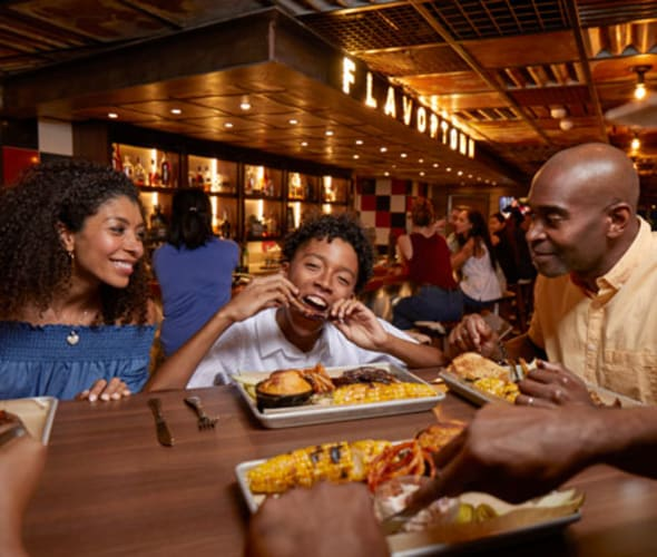 family eating at pig and anchor on carnival cruise line