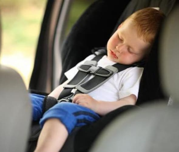 Toddler in a car seat following AAA safety tips