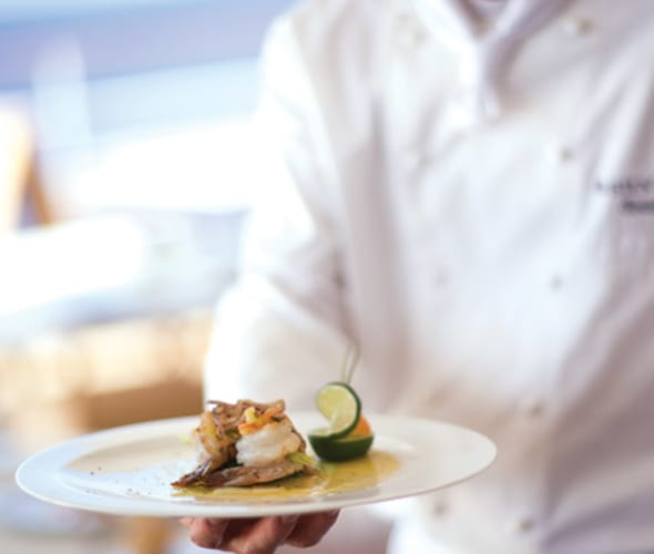 silversea cruises chef with plate of food