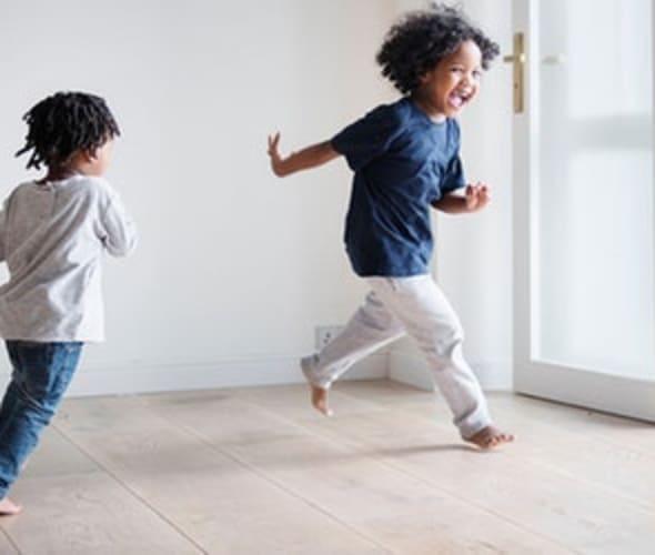 girls run through a new condo townhouse with AAA condominium insurance