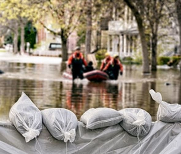 men rescue a homeowner with flood insurance from AAA during a flooding event
