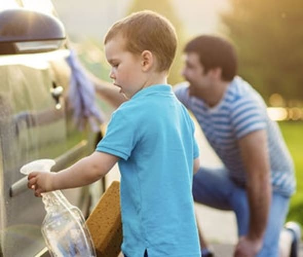 a son helps his father wash a car insured by AAA insurance