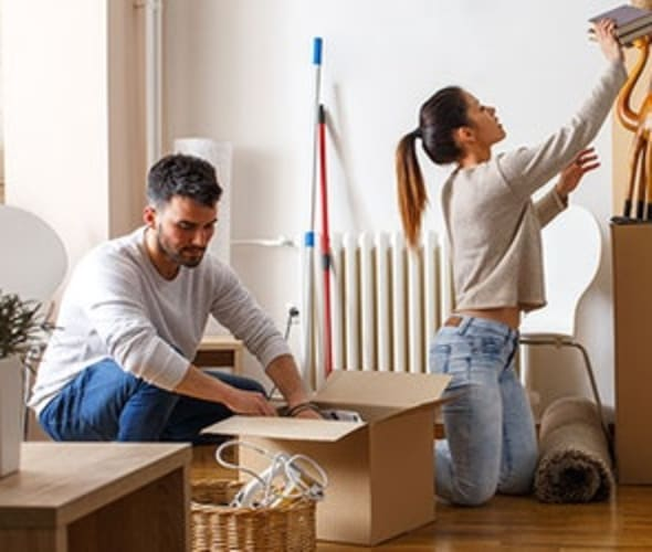 a couple with aaa renters insurance moves into their new apartment